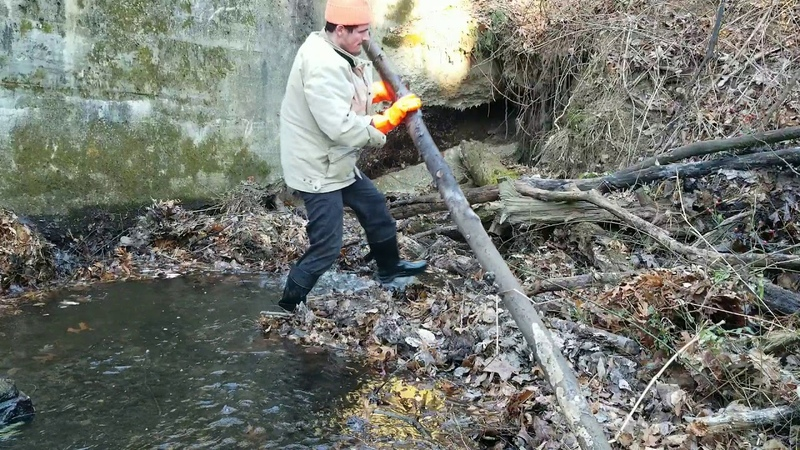 Massive Unclogging Outfall On Dam Uncut Heavy Log Jam
