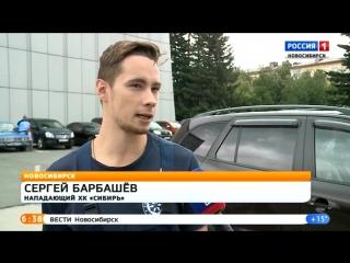 Благотворительная автомойка хк Сибирь с участием хоккеистов и девушек из группы поддержки.