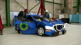 Japan engineers create robot that transforms into car with men on-board