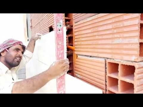 Amazing skillful workers installation natural stone on wall