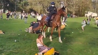 Police attacking people in park in Belgium