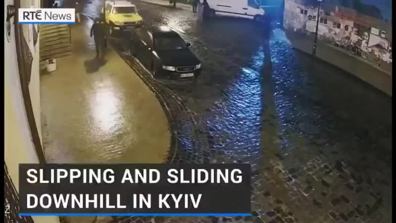 Kyiv Ukraine CCTV captured people struggling to walk downhill due to ice covering the